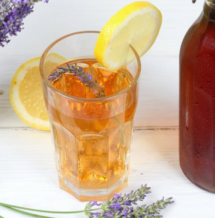 Earl Grey Lavender and Lemonade Iced Tea in tall glass with lemon slice