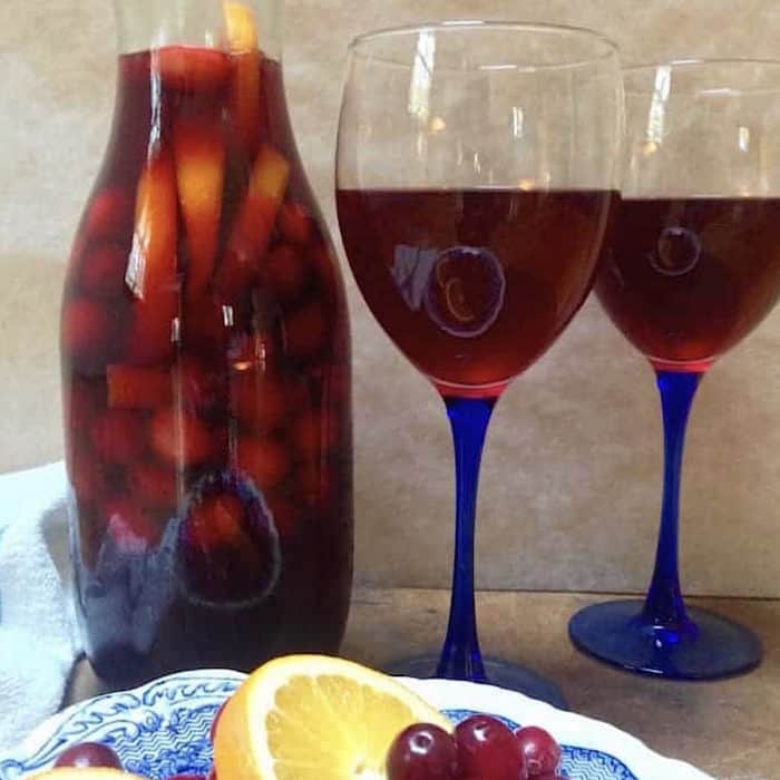 cranberry tea sangria in wine glasses and carafe