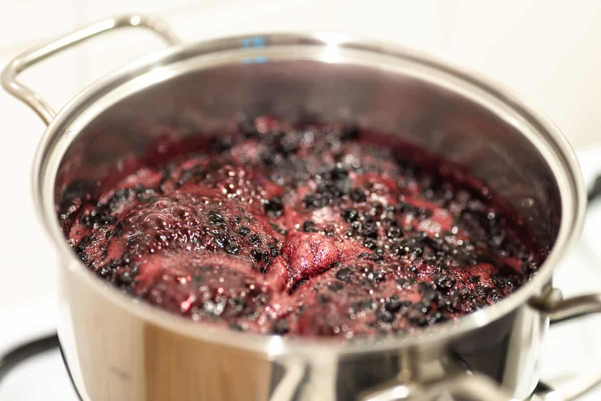 Simmering blueberries in a pot