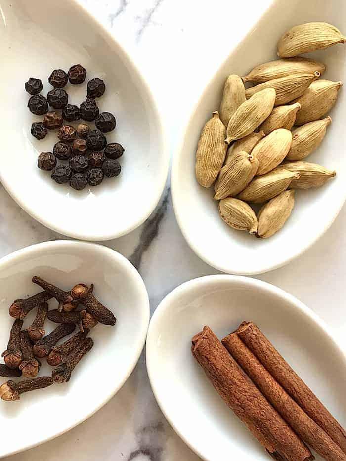 yogi spiced tea spices shown cloves peppercorn cinnamon and cardamon