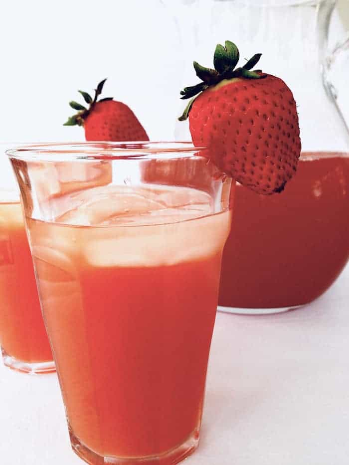 strawberry iced in two glasses with pitcher