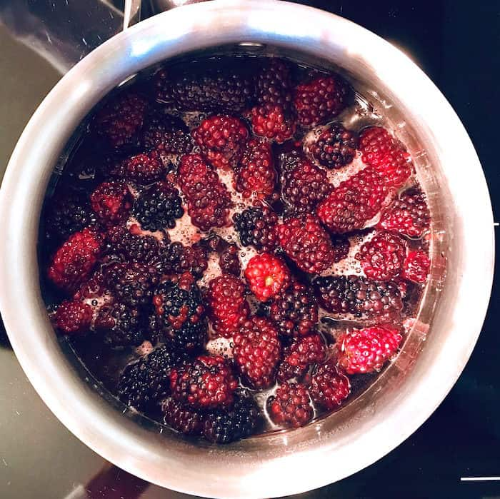 blackberries macerated in earl grey simple syrup in pot