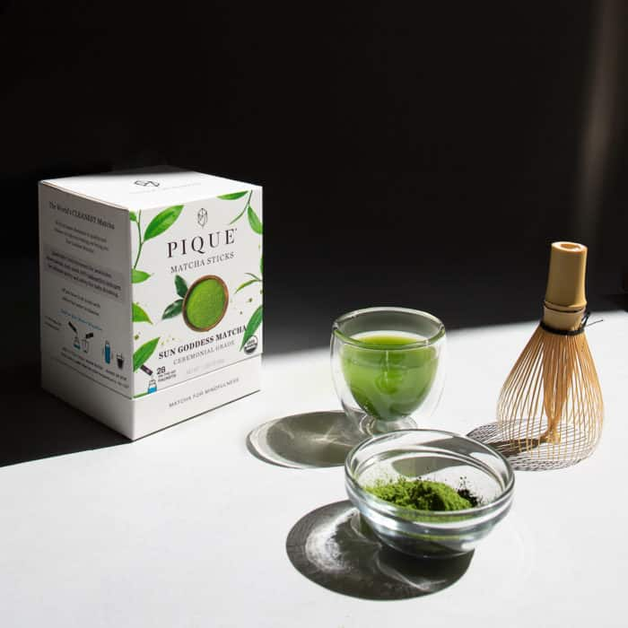 pique sungoddess matcha in a bowl with a whisk and brewd in a glass