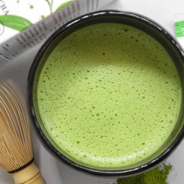 matcha pique tea closeup of frothed matcha in a cup