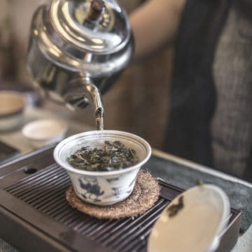 chinese tea ceremony pouring tea into gaiwan