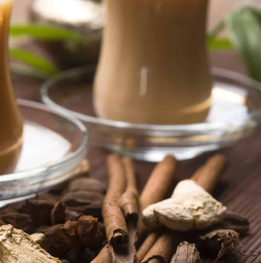 chai latte with spices in front