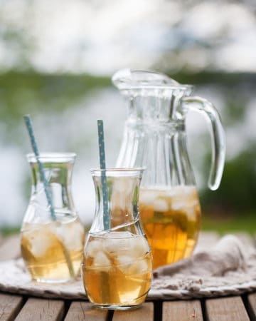 cold brewed iced tea in pitcher with two glasses