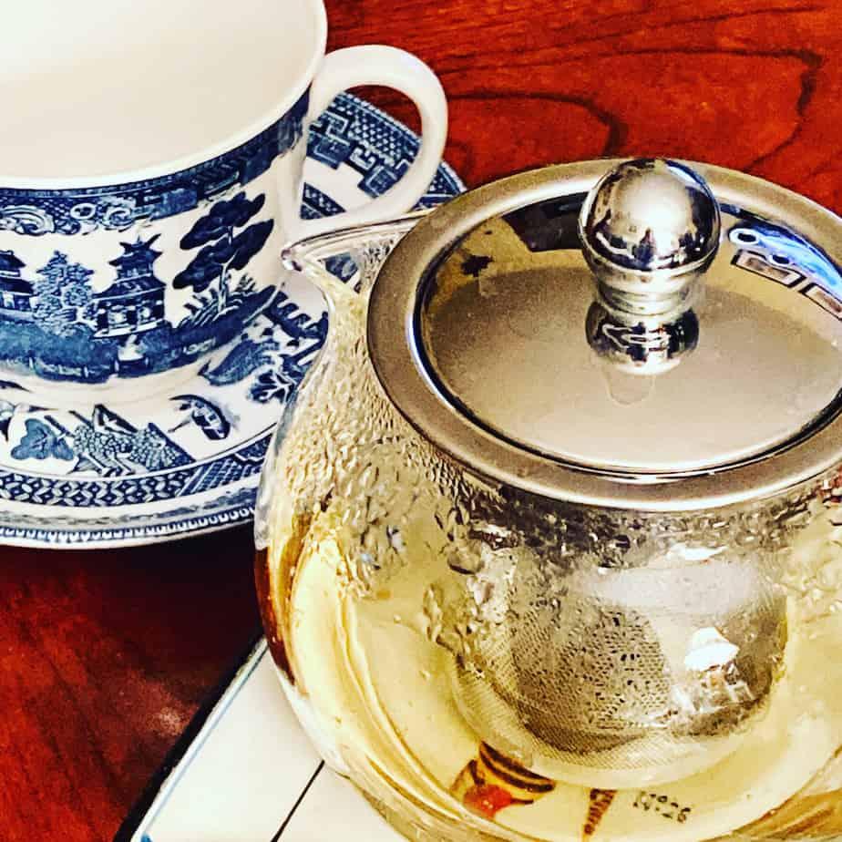 steeping hot chamomile tea in teapot