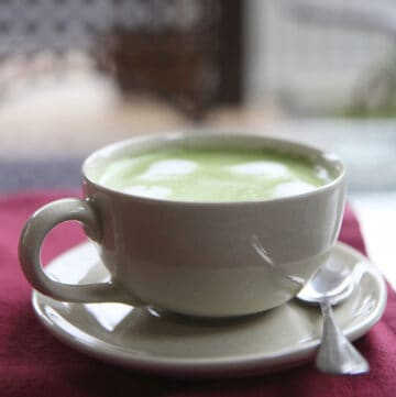 espresso matcha latte in white cup and saucer