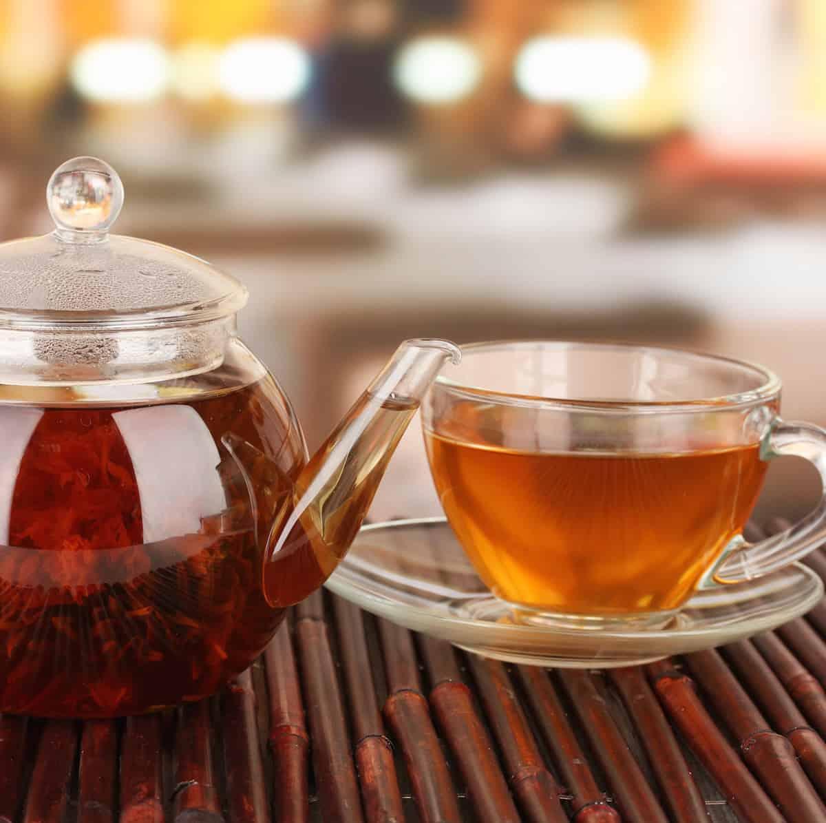 glass teapot and teacups brewing tea