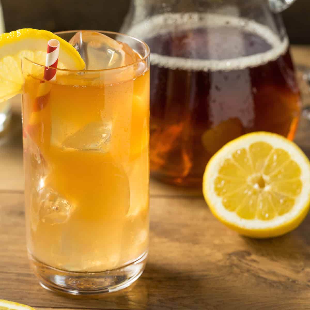 iced tea and lemonade with a pitcher of iced tea in the background
