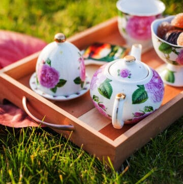 tea outdoors beautiful teaware dishes on a wooden tray outdoors