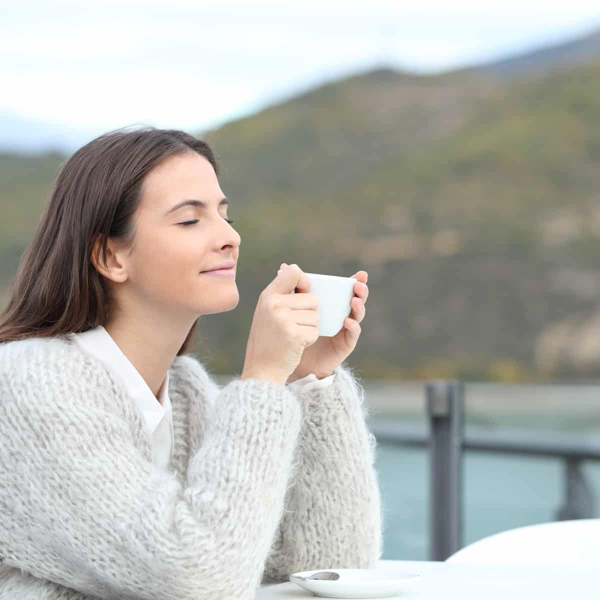 girl drinking tea in nature can naturally reduce stress