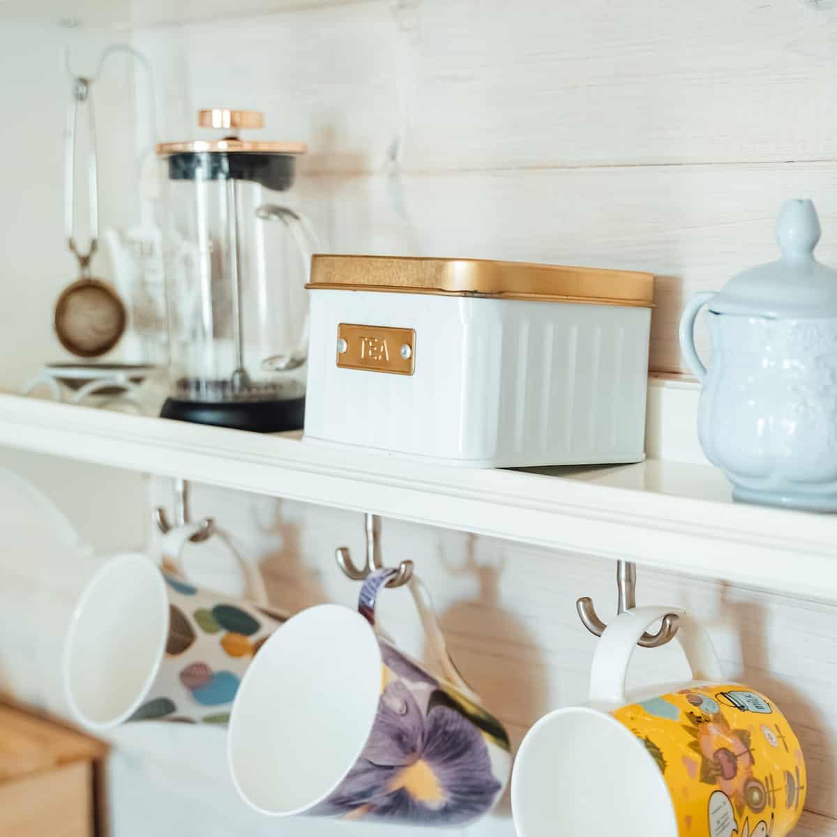 tea organizer on open shelf